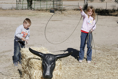Christopher and Sydney practicing roping a steer.