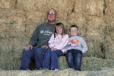 Frank, Christopher and Sydney on the haystack.