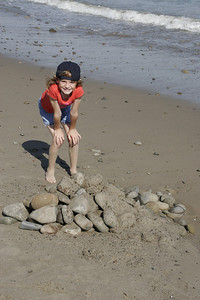 Sydney wanted me to get a picture of her and the rock pile she and Christopher built on the beach.