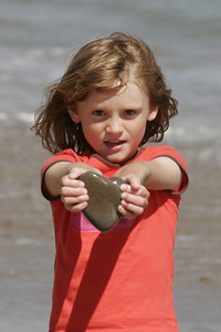 Sydney was happy when she found this heart-shaped rock.