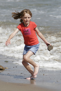 Sydney found a heart-shaped rock and went to wash it off, but a small wave sent her running instead.