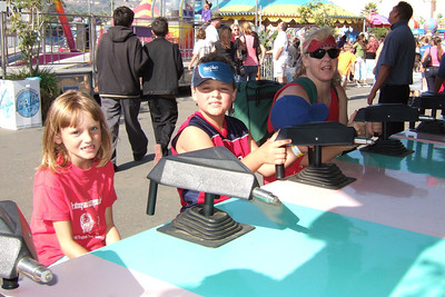 Sydney, Zandler and Bev competing with water guns at the 2005 Ventura County Fair.