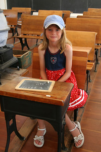 Sydney learning about the one-room schoolhouse. From the sign outside -- La Gloria School was first organized in 1873. The present schoolhouse was built in 1887 and remained in continuous use until 1960. Originally located five miles southeast of Gonzales, the schoolhouse was moved to San Lorenzo Park in 1980. La Gloria School has been restored to its turn-of-the-century condition by the King City Rotary Club.