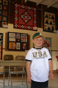 Christopher in front of his favorite quilit (the one with the checkerboard pattern) at the Valley Heritage Days celebration.