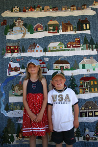 Sydney and Christopher in front of a Christmas Quilt at the Valley Heritage Days celebration. We spent quite a bit of time looking at all of the scenes within this quilt.
