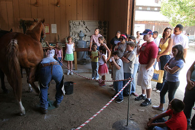 Frank Roth drawing a large crowd as he demonstrates the ferrier trade during Valley Heritage Days.