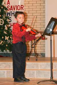 Jaison playing the violin during the music recital for Ms. Krumdiek's students.