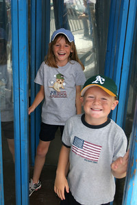 Sydney and Christopher coming out of the glass maze at the Seabee Days carnival