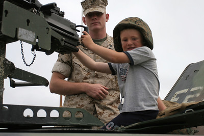 Christopher manning the weapon on a HMMWV at the 2006 Seabee Days.
