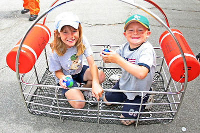 Sydney and Christopher in the US Coast Guard helicopter's rescue basket during the 2006 Seabee Days.