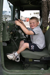 Christopher behind the wheel of a HMMWV at the 2006 Seabee Days