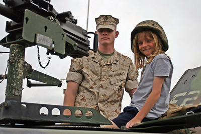 Sydney manning the weapon on a HMMWV at the 2006 Seabee Days.