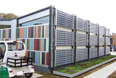 The colorful University of Cincinnati house with an array of evacuated tube solar thermal collectors on the wall. While the girls went shopping, Pat and Christopher headed to the National Mall to enjoy the 2007 Solar Decathlon, which joins twenty college and university teams in a competition to design, build, and operate the most attractive and energy-efficient solar-powered house. (Image taken with FinePix F10 at ISO 200, f4.0, 1/320 sec and 8mm)