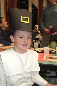 Christopher dressed as a pilgrim for the Taylor Elementary School's Thanksgiving celebration. (Image taken with FinePix F10 at ISO 800, f2.8, 1/100 sec and 8mm)