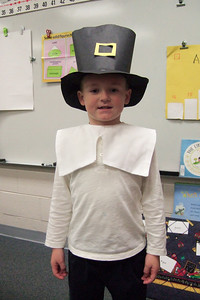 Christopher dressed as a pilgrim for the Taylor Elementary School's Thanksgiving celebration. (Image taken with FinePix F10 at ISO 800, f2.8, 1/180 sec and 8mm)