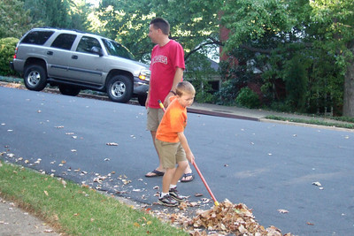 Cleaning up the leaves. (Image taken with FinePix F10 at ISO 800, f3.7, 1/170 sec and 14.1mm)