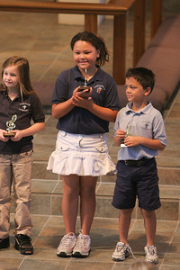 Kids getting their music trophies during chapel at St. John's Lutheran School. (Image taken with Canon EOS 20D at ISO 800, f2.8, 1/100 sec and 195mm)