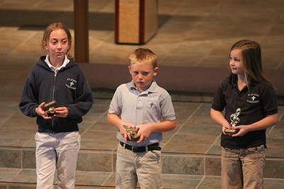 Kids getting their music trophies during chapel at St. John's Lutheran School. (Image taken with Canon EOS 20D at ISO 800, f2.8, 1/160 sec and 200mm)