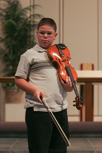 Music Recital. (Image taken with Canon EOS 20D at ISO 800, f2.8, 1/160 sec and 70mm)