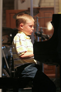 Music Recital. (Image taken with Canon EOS 20D at ISO 800, f2.8, 1/80 sec and 80mm)