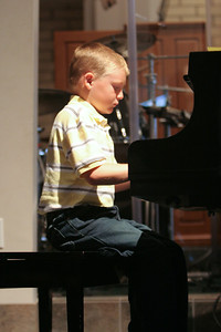 Music Recital. (Image taken with Canon EOS 20D at ISO 800, f2.8, 1/80 sec and 70mm)