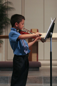Music Recital. (Image taken with Canon EOS 20D at ISO 800, f2.8, 1/100 sec and 73mm)