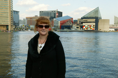 Kathy enjoying a stroll around Baltimore's Inner Harbor after a day trip to the National Aquarium in Baltimore. (Image taken with Canon EOS-1DS at ISO 400, f20.0, 1/80 sec and 46mm)