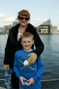 Kathy and Christopher enjoying a stroll around Baltimore's Inner Harbor after a day trip to the National Aquarium in Baltimore. (Image taken with Canon EOS-1DS at ISO 400, f9.0, 1/400 sec and 35mm)