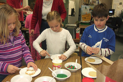Katelyn Kustra, Kelly Gaudian and Jack Schoen. Christopher's 2nd grade classroom Christmas party at Taylor Elementary. (Image taken with FinePix F10 at ISO 800, f2.8, 1/140 sec and 8mm)