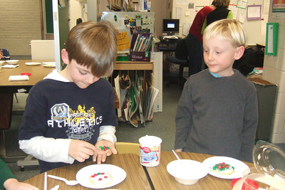 Christopher's 2nd grade classroom Christmas party at Taylor Elementary. (Image taken with FinePix F10 at ISO 800, f2.8, 1/100 sec and 8mm)