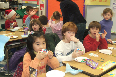 Yuri Jo, Christian McCord-Snook, Sam Goodkind, Laura Wade. Ms. Glover's 2nd grade classroom Christmas party at Taylor Elementary. (Image taken with FinePix F10 at ISO 800, f3.2, 1/100 sec and 10.4mm)
