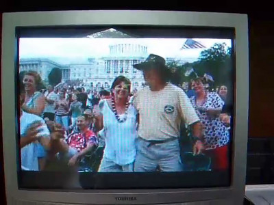 "We're on national TV! Look for Buck and Debbie Thomas bumping hips followed by a quick glimpse of Pat, Kathy, Sydney and Christopher at the end of this snippet.  We celebrated the 4th of July on the West Lawn of the U.S. Capitol with the Buck Thomas family enjoying PBS' A Capitol Fourth--America's biggest and best-loved 4th of July concert, which was hosted by actor Jimmy Smits. We enjoyed performances by Huey Lewis and the News, Jerry Lee Lewis and American Idol winner Taylor Hicks, then watched a spectacular fireworks display with the Washington Monument as the backdrop while the National Symphony Orchestra played Tchaikovsky's ""1812 Overture."""