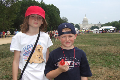 "4th of July on the National Mall. Sydney and Christopher on the way back to the Capitol after enjoying Texas BBQ at the 42nd Annual Smithsonian Folklife Festival on the National Mall, where ""Texas: A Celebration of Music, Food, and Wine"" was one of the main attractions. (Image taken with FinePix F10 at ISO 200, f6.4, 1/640 sec and 8mm)"