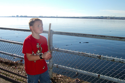 Christopher enjoying throwing sticks into the Potomac River at Hains Point. (Image taken with FinePix F10 at ISO 200, f6.4, 1/680 sec and 8mm)