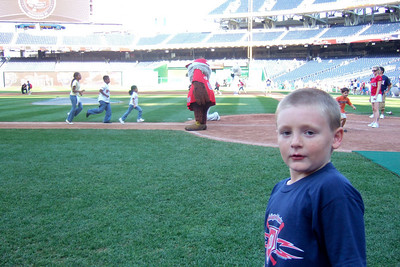 "Christopher after ""Kids Run the Bases"" at Nationals Park. (Image taken with FinePix F10 at ISO 200, f2.8, 1/220 sec and 8mm)"