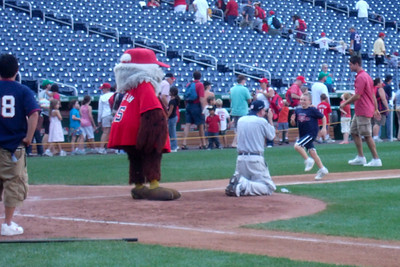 "Christopher coming into home plate during ""Kids Run the Bases"" at Nationals Park. (Image taken with FinePix F10 at ISO 400, f5.0, 1/180 sec and 24mm)"
