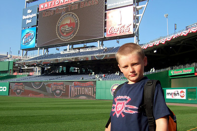 "Christopher heading onto the field for ""Kids Run the Bases"" at Nationals Park. (Image taken with FinePix F10 at ISO 80, f4.5, 1/320 sec and 8mm)"