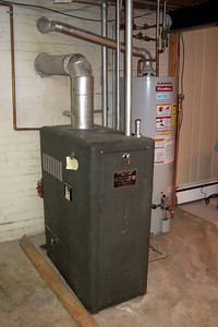 Janitrol Gas Boiler No. 7-22 and 50-gallon hot water heater (Image taken by Patrick R. Kane with FinePix F10 at ISO 800, f2.8, 1/100 sec and 8mm)