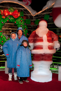 Pat, Sydney and Christopher with an ice Santa Claus at Gaylord National's ICE! (24 Dec 2009) (Image taken by Kathy T. Kane on 24 Dec 2009 with Canon EOS 20D at ISO 400, f4.0, 1/60 sec and 21mm)