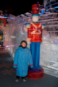 Christopher and a toy soldier made of ice at Gaylord National's ICE! (24 Dec 2009) (Image taken by Kathy T. Kane on 24 Dec 2009 with Canon EOS 20D at ISO 400, f4.0, 1/60 sec and 21mm)