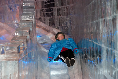 Christopher on the ice slide at Gaylord National's ICE! (24 Dec 2009) (Image taken by Kathy T. Kane on 24 Dec 2009 with Canon EOS 20D at ISO 400, f4.5, 1/60 sec and 70mm)
