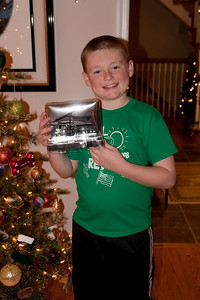 Christopher with the remote control helicopter that was a gift from Uncle John and Aunt Tracy on Christmas Eve 2009 (24 Dec 2009) (Image taken by Kathy T. Kane on 24 Dec 2009 with Canon EOS 20D at ISO 400, f4.0, 1/60 sec and 30mm)