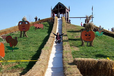 Kathy Rubinger (?) on the big slide at the Cox Farms Pumpkin Patch (Image taken by Sydney J. Kane on 03 Nov 2009 with FinePix F10 at ISO 80, f4.5, 1/400 sec and 8mm)