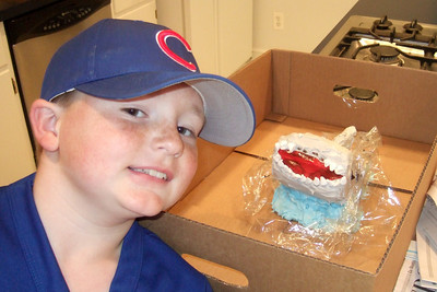 Christopher liked the shark cake that Sydney won for him in a cake walk at the Taylor Spring Fair (02 May 2009) (Image taken with FinePix F10 at ISO 800, f2.8, 1/100 sec and 8mm)