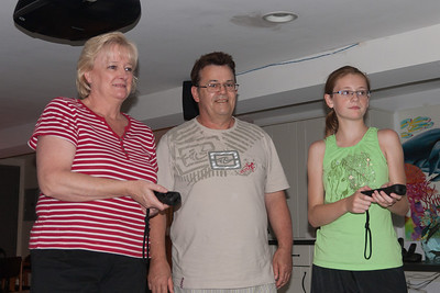 Sydney showing Aunt Gale and Uncle Ivan how to bowl on the Nintendo. (Image taken by Patrick R. Kane on 28 Aug 2010 with Canon EOS 20D at ISO 200, f4.0, 1/60 sec and 30mm)