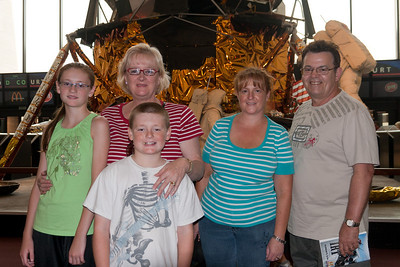 Sydney, Christopher and Kathy Kane showing the National Air and Space Museum to Kathy's sister, Gale, and brother-in-law, Ivan Milic. National Air and Space Museum (Image taken by Patrick R. Kane on 28 Aug 2010 with Canon EOS 20D at ISO 200, f4.0, 1/60 sec and 25mm)