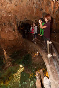 "Kathy, Christopher and Sydney at the far end of the rail next to ""The Wishing Well"" inside Luray Caverns (Image taken by Patrick R. Kane on 15 Aug 2010 with Canon EOS 20D at ISO 200, f3.5, 1/60 sec and 15mm)"