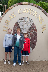 "Sydney, Kathy and Christopher outside the entrance to Luray Caverns. We had to buy the kids a couple of sweatshirts as they only had t-shirts on and it was 54-deg F inside the cave. Christopher isn't happy in this picture because his sleeves were too long. Turns out we didn't need the sweatshirts after all as it was a ""warm"" 54-deg. (Image taken by Patrick R. Kane on 15 Aug 2010 with Canon EOS 20D at ISO 200, f5.6, 1/80 sec and 19mm)"