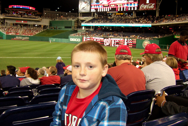 Christopher enjoying great seats for the Washington Nationals vs. Florida Marlins game. Unfortunately, the Nats lost 1 to 3; however, that didn't stop everyone from having a great time. (Image taken by Kathy T. Kane on 10 Sep 2010 with FinePix F10 at ISO 400, f2.8, 1/170 sec and 8mm)