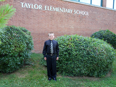 Christopher outside Taylor Elementary School before their Spring Instrumental Music Concert featuring the 4th and 5th grade string orchestras and bands (Image taken by Patrick R. Kane on 17 Jun 2010 with COOLPIX S570 at ISO 320, f2.7, 1/250 sec and 5mm)